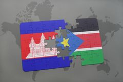 puzzle with the national flag of cambodia and south sudan on a world map Stock Image