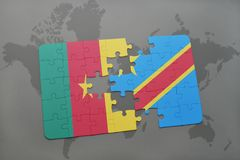 Puzzle with the national flag of cameroon and democratic republic of the congo on a world map. Stock Photo