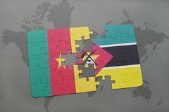 Puzzle with the national flag of cameroon and mozambique on a world map. Puzzle with the national flag of cameroon and mozambique on a world map background. 3D Royalty Free Stock Photography