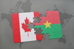 Puzzle with the national flag of canada and burkina faso on a world map background. Royalty Free Stock Image