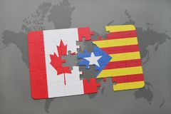 Puzzle with the national flag of canada and catalonia on a world map background. Royalty Free Stock Photo