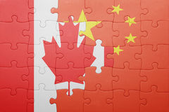 Puzzle with the national flag of canada and china Royalty Free Stock Images