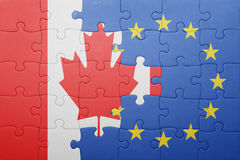 Puzzle with the national flag of canada and european union Royalty Free Stock Photos