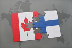 Puzzle with the national flag of canada and finland on a world map background. Royalty Free Stock Photography