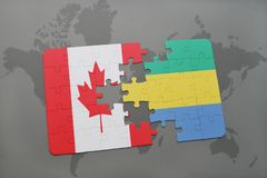 Puzzle with the national flag of canada and gabon on a world map background. Stock Photo
