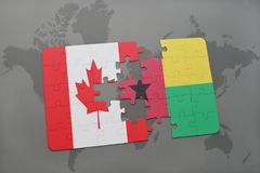 Puzzle with the national flag of canada and guinea bissau on a world map background. Royalty Free Stock Photos
