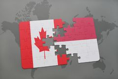 puzzle with the national flag of canada and indonesia on a world map background. royalty free stock photography