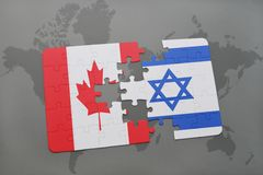 Puzzle with the national flag of canada and israel on a world map background. Royalty Free Stock Photo