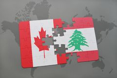 Puzzle with the national flag of canada and lebanon on a world map background. Stock Photo