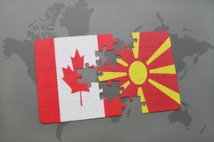 Puzzle with the national flag of canada and macedonia on a world map background. Stock Photography