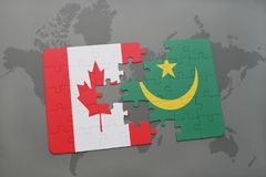 Puzzle with the national flag of canada and mauritania on a world map background. Royalty Free Stock Photo