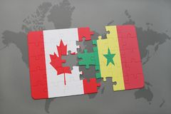 Puzzle with the national flag of canada and senegal on a world map background. Stock Photography