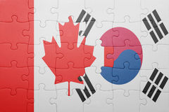 Puzzle with the national flag of canada and south korea royalty free illustration