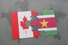 Puzzle with the national flag of canada and suriname on a world map background. 3D illustration Stock Photo