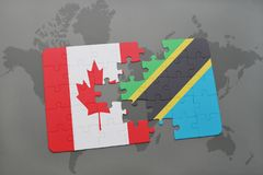 Puzzle with the national flag of canada and tanzania on a world map background. Stock Image