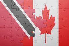 Puzzle with the national flag of canada and trinidad and tobago Stock Photo