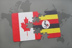 Puzzle with the national flag of canada and uganda on a world map background. 3D illustration Stock Image