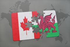 Puzzle with the national flag of canada and wales on a world map background. Stock Photography