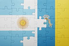 Puzzle with the national flag of canary islands and argentina Royalty Free Stock Images