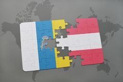 Puzzle with the national flag of canary islands and austria on a world map background. 3D illustration Stock Photos