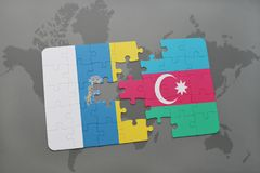 puzzle with the national flag of canary islands and azerbaijan on a world map background. Royalty Free Stock Images