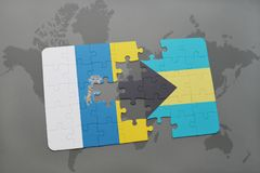 puzzle with the national flag of canary islands and bahamas on a world map background. stock illustration
