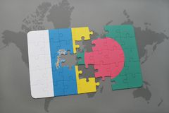 Puzzle with the national flag of canary islands and bangladesh on a world map background. 3D illustration Royalty Free Stock Images