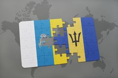 Puzzle with the national flag of canary islands and barbados on a world map background. 3D illustration Royalty Free Stock Photo