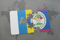 Puzzle with the national flag of canary islands and belize on a world map background. 3D illustration Stock Photo