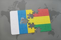 Puzzle with the national flag of canary islands and bolivia on a world map background. 3D illustration Stock Images