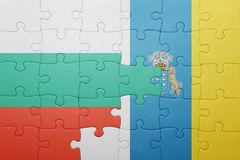 Puzzle with the national flag of canary islands and bulgaria Stock Image