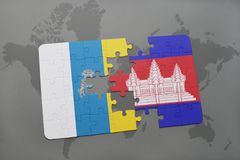Puzzle with the national flag of canary islands and cambodia on a world map background. 3D illustration Royalty Free Stock Images