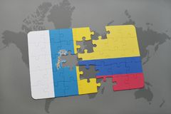 Puzzle with the national flag of canary islands and colombia on a world map background. 3D illustration Royalty Free Stock Photography