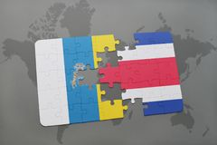 Puzzle with the national flag of canary islands and costa rica on a world map background. 3D illustration Stock Photography