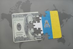 Puzzle with the national flag of canary islands and dollar banknote on a world map background. 3D illustration stock photo