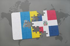 Puzzle with the national flag of canary islands and dominican republic on a world map background. 3D illustration Stock Image