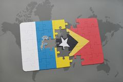Puzzle with the national flag of canary islands and east timor on a world map background. 3D illustration Stock Photos