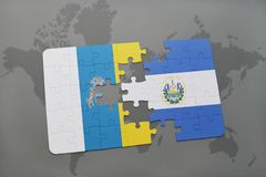 Puzzle with the national flag of canary islands and el salvador on a world map background. 3D illustration Stock Images