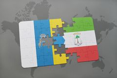 Puzzle with the national flag of canary islands and equatorial guinea on a world map background. 3D illustration Stock Photos