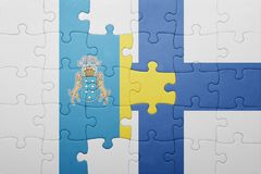 Puzzle with the national flag of canary islands and finland Stock Photo