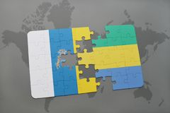 Puzzle with the national flag of canary islands and gabon on a world map background. 3D illustration Stock Image