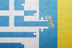 Puzzle with the national flag of canary islands and greece Stock Images
