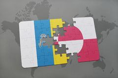 Puzzle with the national flag of canary islands and greenland on a world map background. 3D illustration Stock Photo