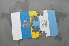 Puzzle with the national flag of canary islands and guatemala on a world map background. 3D illustration Royalty Free Stock Images