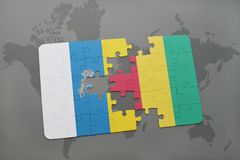 Puzzle with the national flag of canary islands and guinea on a world map background. 3D illustration Royalty Free Stock Image