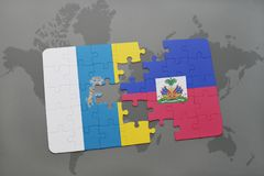 Puzzle with the national flag of canary islands and haiti on a world map background. 3D illustration Stock Photography