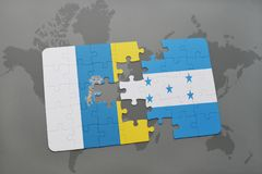 Puzzle with the national flag of canary islands and honduras on a world map background. 3D illustration Royalty Free Stock Photos