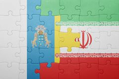 Puzzle with the national flag of canary islands and iran. Concept Stock Image
