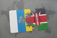 Puzzle with the national flag of canary islands and kenya on a world map background. 3D illustration Stock Photography