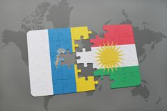 Puzzle with the national flag of canary islands and kurdistan on a world map background. 3D illustration Royalty Free Stock Image